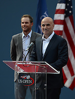 FLUSHING NY- SEPTEMBER 9: Andre Agassi and Andy Roddick during an on court cermony before Serena Williams Vs Victoria Azarenka in the Womens  finals on Arthur Ashe Stadium at the USTA Billie Jean King National Tennis Center on September 9, 2012 in in Flushing Queens. Credit: mpi04/MediaPunch Inc. ***NO NY NEWSPAPERS*** /NortePhoto.com<br />
