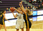 SIOUX FALLS, SD - DECEMBER 7: Kiara James #42 from the University of Sioux Falls shoots against Lindsay Dorr #40 from Concordia St. Paul during their game Friday night at the Stewart Center in Sioux Falls, SD. (Photo by Dave Eggen/Inertia)