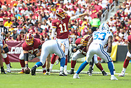 Landover, MD - September 16, 2018: Washington Redskins quarterback Alex Smith (11) changes the play during the  game between Indianapolis Colts and Washington Redskins at FedEx Field in Landover, MD.   (Photo by Elliott Brown/Media Images International)