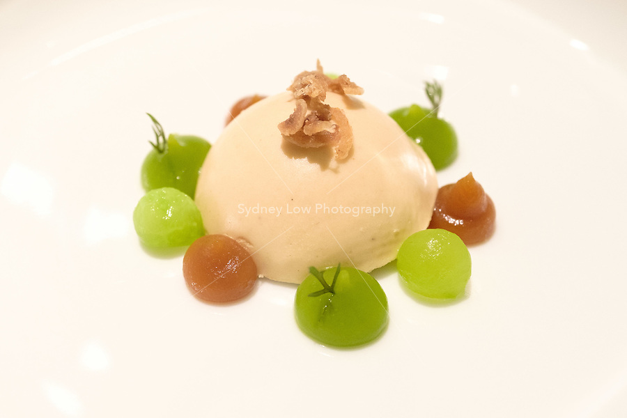 Part of the Peking duck interpreation: a duck liver parfait with gels of pickled cucumber, ginger and leek with duck skin broken up and sprinkled on top of the parfait for texture at Restaurant Tim Raue, Berlin, Germany. Photo Sydney Low