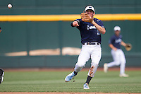 North Carolina outfielder Michael Russell (5) makes a off balance throw to first base against the Louisiana State Tigers during Game 7 of the 2013 Men's College World Series on June 18, 2013 at TD Ameritrade Park in Omaha, Nebraska. The Tar Heels defeated the Tigers 4-2, eliminating LSU from the tournament. (Andrew Woolley/Four Seam Images)
