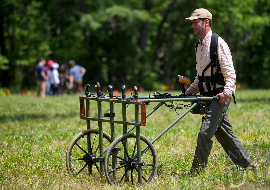 NWA Democrat-Gazette/JASON IVESTER<br /> Dave Maki (cq) with Archaeo-Physics Geophysical Survey uses an array of magnetic gradiometers Thursday, May 18, 2017, in the area of the Leetown Hamlet at the Pea Ridge National Military Park.
