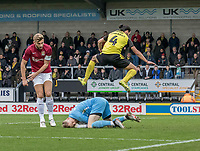 5th January 2020; Pirelli Stadium, Burton Upon Trent, Staffordshire, England; English FA Cup Football, Burton Albion versus Northampton Town; Northampton Town Goalkeeper David Cornell collect the ball  as Ryan Edwards of Burton Albion jumps over him - Strictly Editorial Use Only. No use with unauthorized audio, video, data, fixture lists, club/league logos or 'live' services. Online in-match use limited to 120 images, no video emulation. No use in betting, games or single club/league/player publications