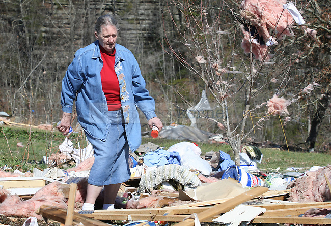 Bertha Goins helped to retrieve the belongings from her daughter's home in Laurel County, Ky., on March 3, following the March 2, 2012 tornado in which five people in the county were killed. Her daughter's home, which she had lived in for 18 years, was completely destroyed. Photo by Latara Appleby | Staff ..