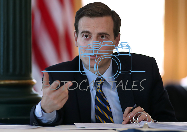 Nevada Attorney General Adam Laxalt works in a Board of Examiners meeting in Carson City, Nev., on Tuesday, Feb. 10, 2015. <br /> Photo by Cathleen Allison