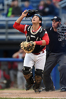 Batavia Muckdogs catcher Christopher Hoo (5) looks for a pop up in front of umpire Christopher Stump during the second game of a doubleheader against the Williamsport Crosscutters on July 29, 2014 at Dwyer Stadium in Batavia, New York.  Batavia defeated Williamsport 1-0.  (Mike Janes/Four Seam Images)
