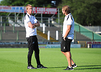 Swansea City manager Graham Potter  talks with Swansea City assistant manager Billy Reid during the Pre-Season Friendly between Yeovil and Swansea City at Huish Park, Yeovil, England, UK. Tuesday 10 July 2018