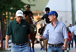 LOUISVILLE, KY --MAY 14: WinStar Farm's Elliott Walden (left, green shirt), co-owner of Kentucky Derby winner Justify, walks in front of his horse to the track at Churchill Downs, Louisville, Kentucky. Justify is preparing for the Preakness Stakes in Baltimore, Maryland. (Photo by Mary M. Meek/Eclipse Sportswire/Getty Images)