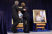 Washington, DC - December 19, 2008 -- United States President George W. Bush and first lady Laura Bush unveil the National Portrait Gallery's Portraits of The President and Mrs. Bush at the National Portrait Gallery in Washington DC, Friday, December 19, 2008. .Credit: Ken Cedeno / Pool via CNP