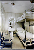 BNPS.co.uk (01202 558833)<br /> Pic:    CanterburyAuctionGalleries/BNPS<br /> <br /> Bunk beds inside one of the third class state rooms.<br /> <br /> Remarkable photos of the iconic ocean liner SS Normandie which was like a 'floating palace' have come to light over 80 years later.<br /> <br /> The giant 1,000ft long French passenger ship was the largest of her type in the world and won the coveted 'Blue Riband' for the fastest crossing of the Atlantic.<br /> <br /> English photographer Percy Byron's photos show the liner's luxurious 'Art Deco' interior with its chandeliers and pillars of Lalique glass.<br /> <br /> The vessel, which launched in 1935, even boasted its own swimming pool and a gym where young women can be seen doing aerobics while a man in a suit trains with a punch bag.