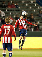 CARSON, CA – APRIL 9, 2011: Chivas USA midfielder Ben Zemanski (21) heads the ball during the match between Chivas USA and Columbus Crew at the Home Depot Center, April 9, 2011 in Carson, California. Final score Chivas USA 0, Columbus Crew 0.