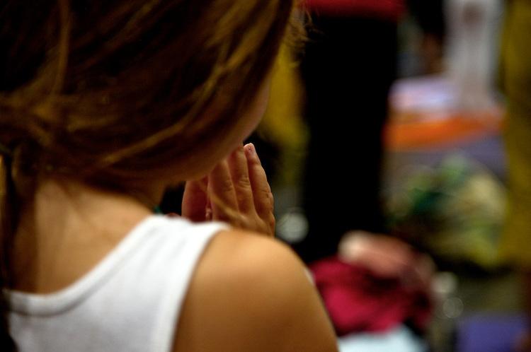 Global Mala Project (GMP) event.  108 Sun Salutations (Surya Namaskars).  Young girl doing yoga.