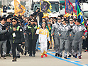 You Young, Nov 1, 2017 : South Korean figure skater You Young (C) who is the first torch bearer runs with an Olympic torch at the Olympic Torch Relay on the Incheon Bridge in Incheon, west of Seoul, South Korea. The Olympic flame arrived in Incheon, South Korea on Wednesday and it is going to be passed across the country during a 100-day tour until the opening ceremony of the 2018 PyeongChang Winter Olympics which will be held for 17 days from February 9 - 25, 2018. (Photo by Lee Jae-Won/AFLO) (SOUTH KOREA)