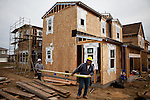 Construction workers work in a new Folsom, California housing development, March 15, 2013.