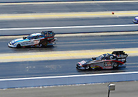 Apr. 14, 2012; Concord, NC, USA: NHRA funny car drivers Tim Wilkerson (left) and Blake Alexander race during qualifying for the Four Wide Nationals at zMax Dragway. Mandatory Credit: Mark J. Rebilas-
