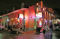 Rainy evening lighting people French Quarter New Orleans Louisiana