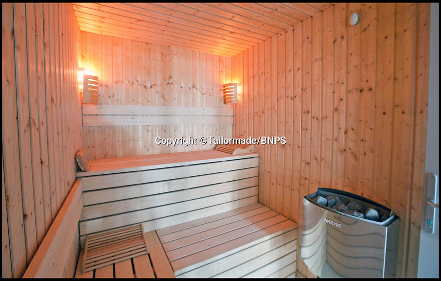 BNPS.co.uk (01202) 558833<br /> Pic: Tailormade/BNPS<br /> <br /> Sauna...<br /> <br /> This state of the art mega-home is for sale on the exclusive millionaires playground of Sandbanks in Poole, Dorset.<br /> <br /> The biggest, most expensive, and luxurious home ever to come on the market on the tiny peninsula, it is now selling for a cool £8.75m.<br /> <br /> Called The Moorings, the harbour front mansion has stunning sea views, and is on one of the most enviable plots on Millionaire's Row.<br /> <br /> Its owners, entrepreneur Chris Thomas and wife Sue, spent a staggering £5.5m building the palatial home that has been compared to a five star hotel.<br /> <br /> Spread over 13,000 sq ft - the equivalent size of seven detached houses - the state-of-the art property comes with five en suite bedrooms, three reception rooms, an office, cinema room, indoor swimming pool, sauna, gym, gate house and boat house.