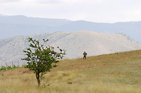 View over the mountains. Man walking. Amyndeon Amindeo region, Macedonia, Greece