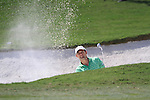 Padraig Harrington chips out of a greenside bunker at the 15th green during Day 3 of the Dubai World Championship, Earth Course, Jumeirah Golf Estates, Dubai, 27th November 2010..(Picture Eoin Clarke/www.golffile.ie)