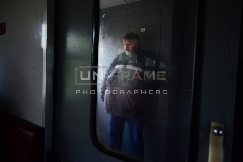 Worker of Chernobyl Nuclear Power Plant on his way to work. Special train is connects Slavutich city and the territory of the plant. Train has no stops, crosses official Belarusian border and returns to Ukraine. It takes approximately 40 minutes to get to destination.