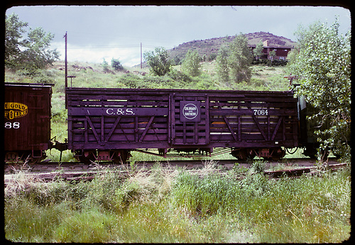 Side view of C&amp;S stock car #7064 at Colorado Railroad Museum.  It became RGS #7201 in 1938.  The CRRM at one time had one side lettered C&amp;S and the other side RGS.<br /> C&amp;S  Golden, CO  ca. 1970