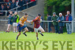 Nigel O'Connor Duagh is closely marked by Beaufort Captain Ger hartnett during their Junior Championship quarter final in Beaufort on Saturday