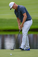 Alex Noren (SWE) sinks his putt on 3 during 2nd round of the World Golf Championships - Bridgestone Invitational, at the Firestone Country Club, Akron, Ohio. 8/3/2018.<br /> Picture: Golffile | Ken Murray<br /> <br /> <br /> All photo usage must carry mandatory copyright credit (© Golffile | Ken Murray)