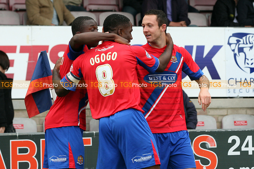 Rhys Murphy of Dagenham and Redbridge is congratulated after  scoring the second goal -  Dagenham and Redbridge vs Bury at the London Borough of Barking and Dagenham Stadium - 28/09/13 - MANDATORY CREDIT: Dave Simpson/TGSPHOTO - Self billing applies where appropriate - 0845 094 6026 - contact@tgsphoto.co.uk - NO UNPAID USE