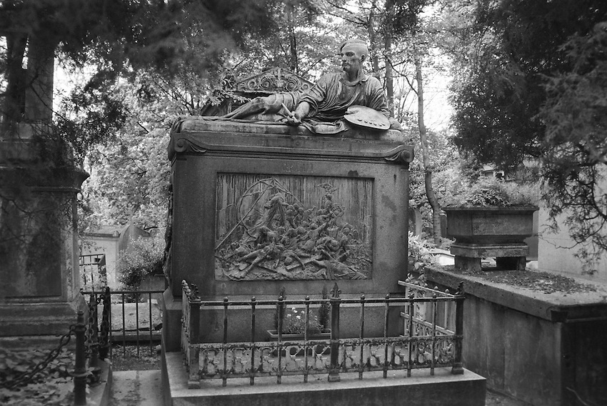 A sculpture of the The Artist of The French Revolution reclining atop his own grave, an ostensible rest, having completed The Raft Of The Medusa, at The Père Lachaise Cemetery, Paris