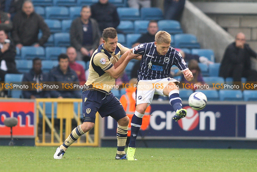 Jason Pearce of Leeds United and Martyn Waghorn of Millwall- Millwall vs Leeds United - Sky Bet Championship Football at the New Den, South Bermondsey, London - 28/09/13 - MANDATORY CREDIT: George Phillipou/TGSPHOTO - Self billing applies where appropriate - 0845 094 6026 - contact@tgsphoto.co.uk - NO UNPAID USE