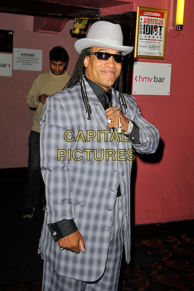 Melle Mel.'Something For Nothing: The Art of Rap'  European premiere arrivals, Hammersmith Apollo, London, England. 19th July 2012..half length grey gray plaid checked suit hat sunglasses waistcoat microphone necklace hand .CAP/MAR.© Martin Harris/Capital Pictures.