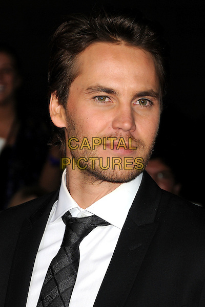 "Taylor Kitsch.""John Carter"" Los Angeles Premiere held at Regal Cinemas L.A. Live, Los Angeles, California, USA..February 22nd, 2012.headshot portrait black white shirt tie stubble facial hair.CAP/ADM/BP.©Byron Purvis/AdMedia/Capital Pictures."