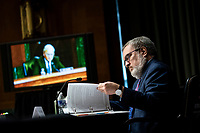 Andrew Wheeler, Administrator, United States Environmental Protection Agency (EPA), reviews his notes during a US Senate Environment and Public Works Committee hearing, on Capitol Hill in Washington, D.C., U.S., on Wednesday, May 20, 2020. <br /> Credit: Al Drago / Pool via CNP/AdMedia