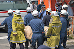 10th Anniversary File Photo: Rescue workers remove the remains of a passenger from a train that crashed into a building in Amagasaki, Japan on April 25 2005. 107 people were killed in the accident, 562 were injured.<br /> <br /> The accident was Japan's most serious since a train accident in 1963 killed 162 people. (Photo by Duits.co/AFLO)
