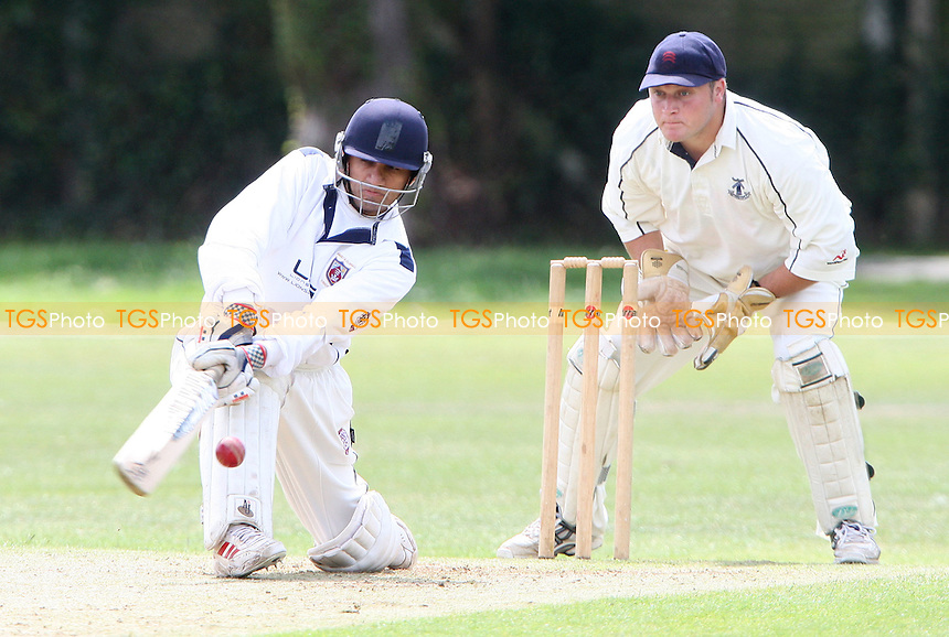 Hainault batsman Yasin Patel and Upminster wicket keeper M Squibb - Upminster Cricket Club vs Hainault & Clayhall Cricket Club, Essex Cricket League at Upminster Park, Upminster - 25/07/09 - MANDATORY CREDIT: Rob Newell/TGSPHOTO - Self billing applies where appropriate - 0845 094 6026 - contact@tgsphoto.co.uk - NO UNPAID USE.