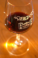 Glass of red wine with a picture of the winery and the text Les Verdots Domaine Vignoble des Verdots Conne de Labarde Bergerac Dordogne France