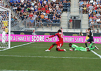 CHESTER, PA - AUGUST 12, 2012:  Chandler Hoffman (12) of the Philadelphia Union turns away as  Jalil Anibaba (6) and  Sean Johnson (25) of the Chicago Fire watch the ball enter the goal for an own goal for the Union during an MLS match at PPL Park, in Chester, PA on August 12. Fire won 3-1.