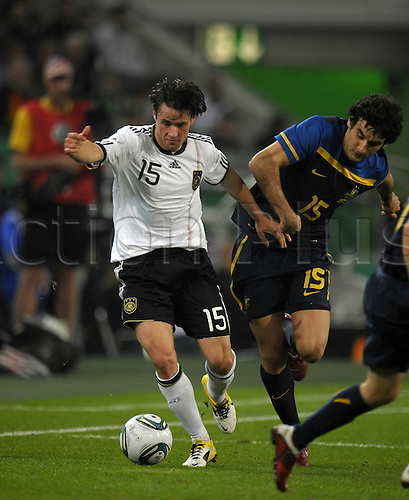 29 03 2011  international match Germany Australia in Moenchengladbach v left Christian Tr‰sch Germany against Mile Jedinak Australia Football men ger DFB National team international match Moenchengladbach