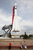 RUSSIA, Moscow. Visitors at the space pavilion with a copy of the Vostok Rocket at the All-Russia Exhibition Center.