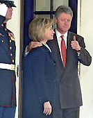 "United States President Bill Clinton gives a ""thumbs-up"" when asked about his meeting at the White House in Washington, D.C. with King Hussein of Jordan on March 19, 1998.  First lady Hillary Rodham Clinton looks on..Credit: Ron Sachs / CNP"