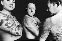 Former Yakuza (Japanese gangstars) turned into missionaries show their tatoos.<br />