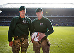 Royal Marines Commandos with the matchball after abseiling from the roof of the Govan Stand before kickoff