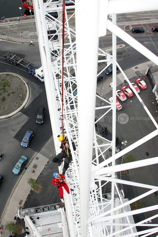 25/08/'10 Teena Gates, Head of News at 98FM pictured with Mike O'Shea of Work at Height  at the Wheel of Dublin at the O2 this morning abseiling the 60 meters down from the top of the Wheel. After climbing her own personal mountain, recovering from illness, chronic back pain and loosing 10 stone in 12 months, Teena is heading to Mount Everest Base Camp this October as part of a celebrity fundraiser for the Hope Foundation and street kids in Calcutta....Picture Colin Keegan, Collins, Dublin.