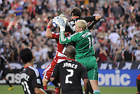 FC Dallas goalkeeper Kevin Hartman (1) goes up to defend the play.    FC Dallas defeated DC United 3-1 at RFK Stadium, Saturday August 14, 2010.