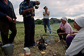 Kerga, Russia<br /> July, 1998<br /> <br /> Farmers take a break from cut, rack and stack hay in an abandoned village.