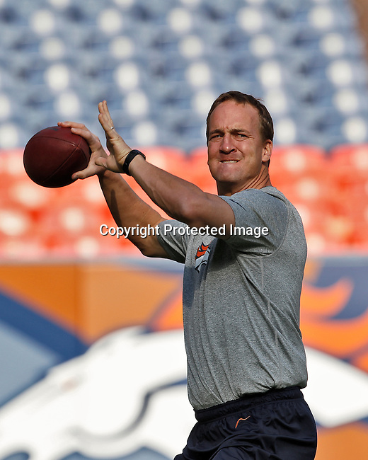 Denver Broncos quarterback Peyton Manning (18) warms up prior to the game against the Seattle Seahawks.  The Seahawks defeated the Broncos 30-10 in an NFL preseason game Saturday, August 18, 2012, in Denver, Co. (AP Photo/Margaret Bowles)