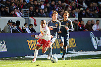 Dane Richards (19) of the New York Red Bulls and Mike Magee (18) of the Los Angeles Galaxy battle for the ball  during the 1st leg of the Major League Soccer (MLS) Western Conference Semifinals at Red Bull Arena in Harrison, NJ, on October 30, 2011.