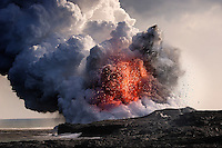 Explosions and steam clouds where lava from the Big Island's Kilauea volcano reaches the Pacific Ocean.