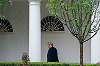 United States President Donald J. Trump walks through the Colonnade of the White House after a Rolling to Remember ceremony honoring the nation's veterans and prisoners of war/missing in action (POW/MIA) in Washington, D.C., U.S., on Friday, May 22, 2020. Trump didn't wear a face mask during most of his tour of Ford Motor Co.'s ventilator facility Thursday, defying the automaker's policies and seeking to portray an image of normalcy even as American coronavirus deaths approach 100,000. <br /> Credit: Andrew Harrer / Pool via CNP / MediaPunch