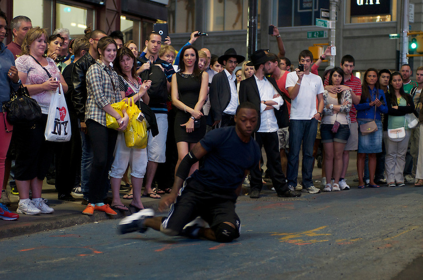 "September 13, 2012, the super talented New York street dance crew ""Wanted Technique"" wow  a Times Square audience with a very funny, physically daring show, great stuff until the NYPD remind the lads of a city ordinanance.  It really begs the question of why such a  talented group can't be sanctioned to perform for the public.  Crew members include bboy snackz (with the Mohawk), half - and - half (black and white hair), and Dewey (camo shorts, palm leaf t-shirt)."